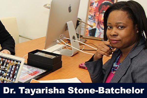 Dr. Tayarisha Stone-Batchelor sitting at a desk during a partnership meeting